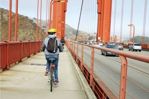 man cycling on golden gate