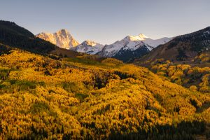 Fall foliage color and big mountain with snow on top. Capital Peak, Snowmass Wilderness, Colorado