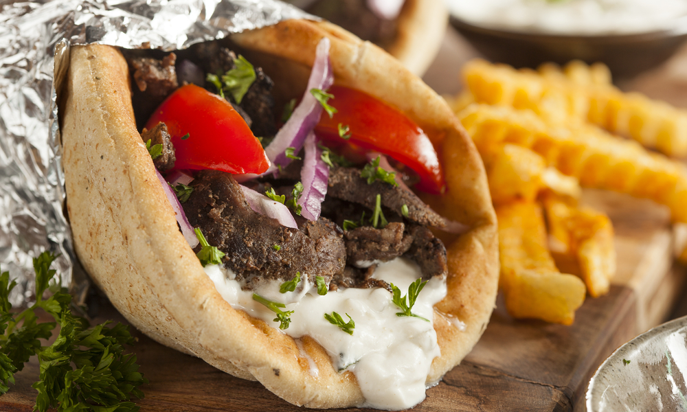 Homemade Meat Gyro with Tzatziki Sauce, tomatos and French Fries