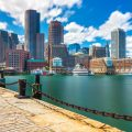Boston cityscape in sunny day, view from harbor on downtown, Massachusetts, USA