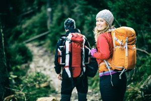 Man and woman hikers trekking in mountains