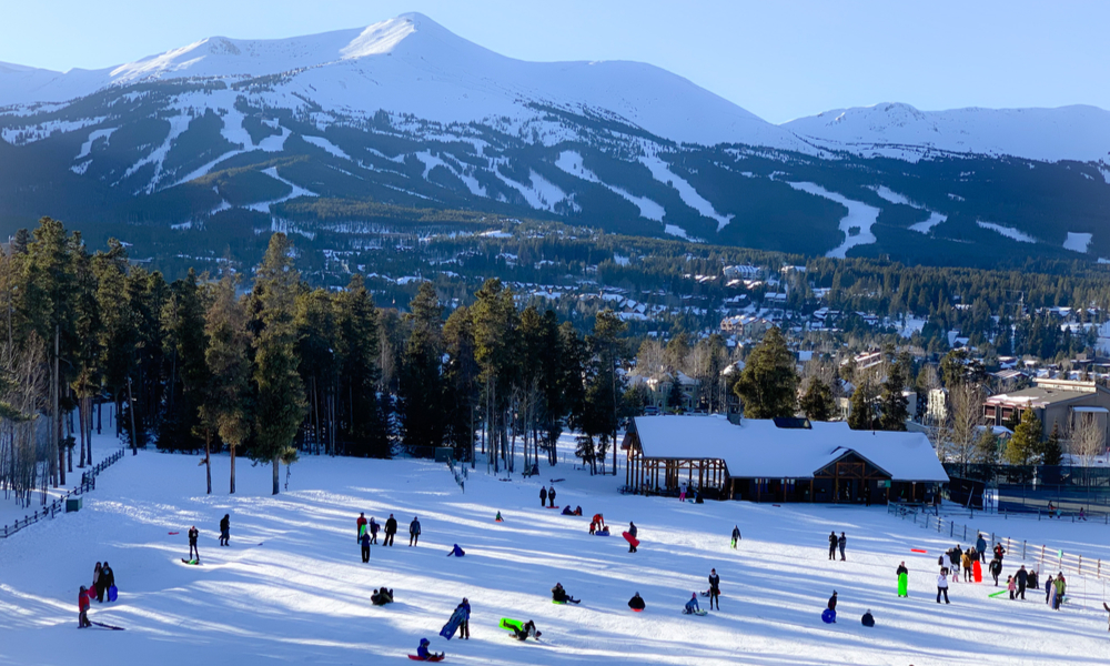 Exciting & adventurous things to do in denver: Kids sledding at Carter Park on a snowy hill in Breckenridge, Colorado.