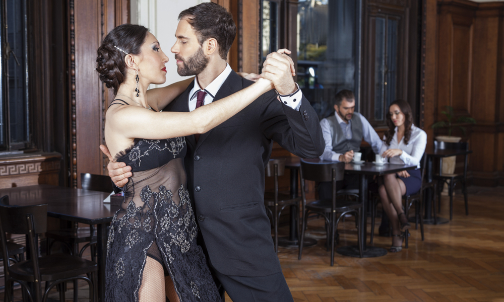 A Guide to the Romantic Side of Denver:Dancers Doing Tango While Mid Adult Couple Dating